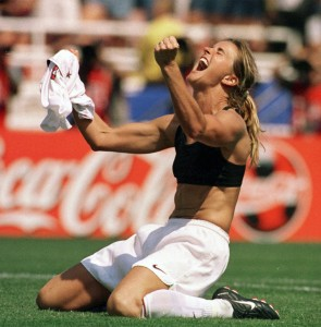 Brandi Chastain taking her shirt off triumphantly after winning the World Cup