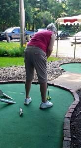 Ginny playing mini golf July 11